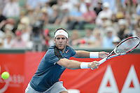 MELBOURNE, AUSTRALIA - JANUARY 12: JUAN MARTIN DEL POTRO (ARG) in action against LLEYTON HEWITT (AUS)  in the 2013 AAMI Classic event at the Kooyong Lawn Tennis Club in Melbourne, Australia. Hewitt won 6-1 6-4 (Photo Sydney Low)