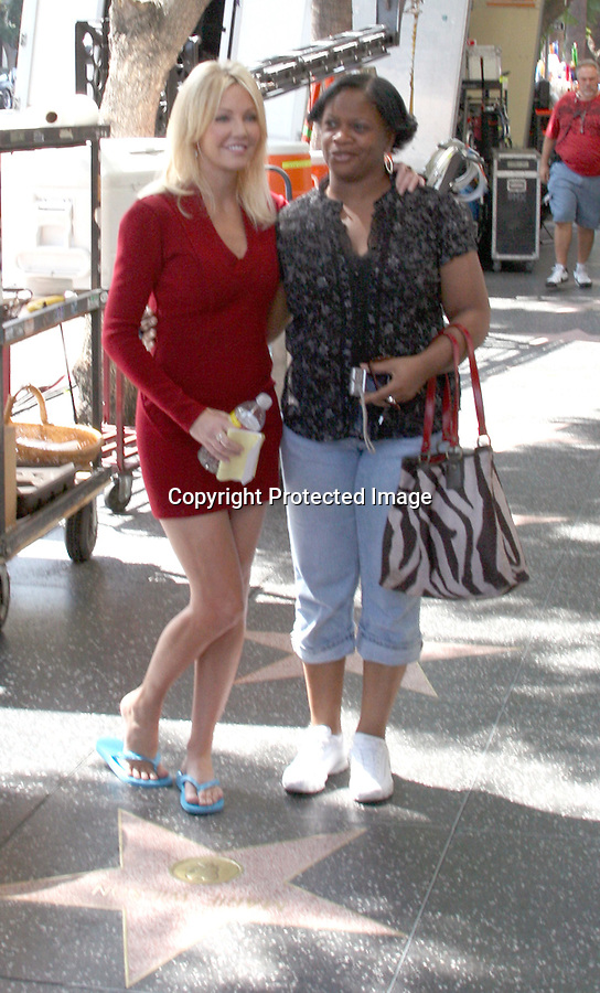 9-29-09..First pictures of Heather Locklear back on the set of Melrose Place.  Heather was wearing a very pretty red dress & took pictures with fans on Hollywood blvd.  Heather seemed extremely happy to be back on set. ....AbilityFilms@yahoo.com.805-427-3519.www.AbilityFilms.com