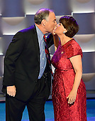 United States Senator Tim Kaine (Democrat of Virginia) kisses his wife, Anne, after completing his remarks accepting the Democratic Party nomination for Vice President of the US during the third session of the 2016 Democratic National Convention at the Wells Fargo Center in Philadelphia, Pennsylvania on Wednesday, July 27, 2016.<br /> Credit: Ron Sachs / CNP<br /> (RESTRICTION: NO New York or New Jersey Newspapers or newspapers within a 75 mile radius of New York City)