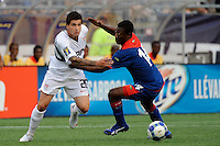 Santino Quaranta (20) of the United States (USA) is marked by Mones Chery (14) of Haiti (HAI). The United States and Haiti played to a 2-2 tie during a CONCACAF Gold Cup Group B group stage match at Gillette Stadium in Foxborough, MA, on July 11, 2009. .