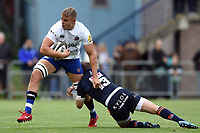 Tom Ellis of Bath Rugby is tackled by James Johnstone of Edinburgh Rugby. Pre-season friendly match, between Edinburgh Rugby and Bath Rugby on August 17, 2018 at Meggetland Sports Complex in Edinburgh, Scotland. Photo by: Patrick Khachfe / Onside Images