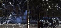 Roma,15 Ottobre 2011.Manifestazione contro la crisi e l'austerità..Corteo e scontri con le forze dell'ordine.Petardi contro la polizia