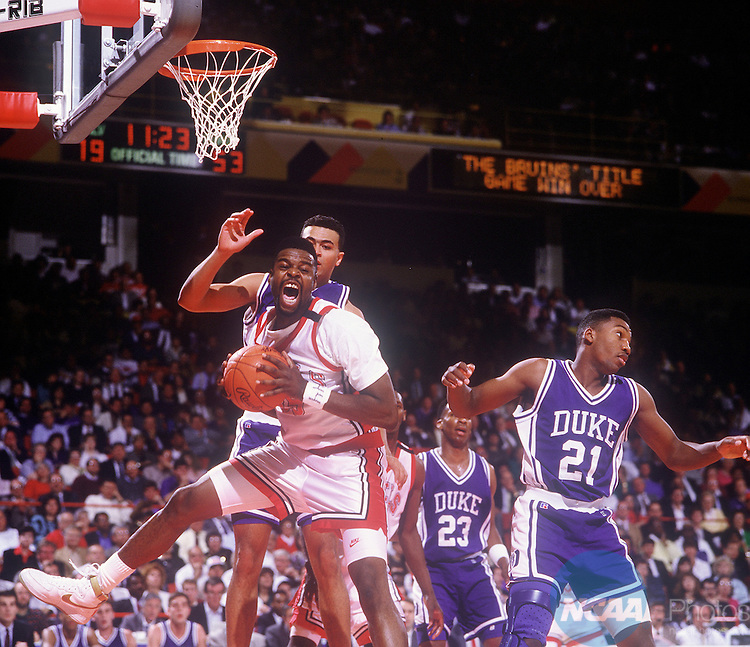 02 APR 1990:  UNLV forward Moses Scurry (35) grabs a rebound during the NCAA National Basketball Final Four Championship game at McNichols Arena in Denver, CO.  UNLV defeated Duke 103-73 for the title. Rich Clarkson/NCAA Photos