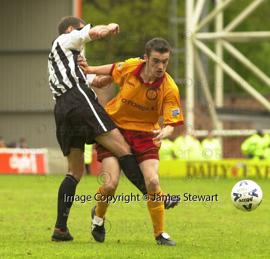 20th May 2001   Copyright Pic : James Stewart .Ref :                           .File Name : stewart21-motherwell v st mirren.MOTHERWELL'S KEITH LASLEYGETS A PAINFUL KICK FROM TOMMY TURNER......James Stewart Photo Agency, Stewart House, Stewart Road, Falkirk. FK2 7AS      Vat Reg No. 607 6932 25.Office : +44 (0) 1324 630007     Mobile : 07721 416997.Fax     :  +44 (0) 1324 630007.E-mail : jim@jspa.co.uk.If you require further information then contact Jim Stewart on any of the numbers above.........