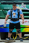 HAINAN ISLAND, CHINA - AUGUST 23:  Vytautas Lalas of Lithuania competes at the Truck Pull event during the World's Strongest Man competition at Serenity Marina on August 23, 2013 in Hainan Island, China.  Photo by Victor Fraile