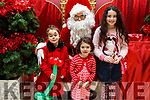 Brooke Cunningham (Tralee), Caoimhe Brosnan and Annie Brassil (Killahan) visiting Santa at Manor West Shopping Centre on Saturday.