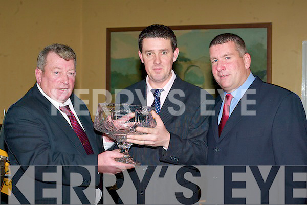 Timothy Hickey and Patrick O'Sullivan presents Matt Courtney (centre) the Eddie Barry Supporter of the Year trophy at the Dr Crokes GAA club social in the Dromhall Hotel, Killarney on Saturday  .   Copyright Kerry's Eye 2008