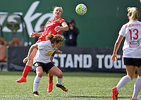 Portland, Oregon - Sunday October 2, 2016: Portland Thorns FC midfielder Lindsey Horan (7) is blocked by Western New York Flash defender Elizabeth Eddy (4) during a semi final match of the National Women's Soccer League (NWSL) at Providence Park.