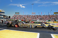 Jun. 2, 2012; Englishtown, NJ, USA: NHRA top fuel dragster driver Khalid Albalooshi (near lane) races alongside Terry McMillen during qualifying for the Supernationals at Raceway Park. Mandatory Credit: Mark J. Rebilas-