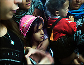 Athens 31.10.2011 Greece<br /> The organization Doctors of the World in Athens. Children waiting for medication. Because of the crisis, the number of people whom the organization must support grows rapidly.<br /> For many years Greek governments increased spending despite unability to settle the public debt reaching now the amount of 300 billion euros. But that is not the sole problem. The Greek economy crises is also due to the corruption that pervades every corner of day to day life in the country. Transparency International proves that bribery, patronage and other public corruption costs .Greece 8% of its GDP annually, placing the counrty among top of the list of countries drowning in systemic corruption.<br /> Photo: Adam Lach / Napo Images<br /> <br /> Organizacja Lekarze Swiata w Atenach. Dzieci czekaja na leki. Z powodu kryzysu liczba ludzi, ktorym organizacja musi pomoc gwaltownie rosnie.<br /> Przez wiele lat greckie rzady zwiekszaly wydatki bez pokrycia, wynikiem tego jest skumulowanie dlugu publicznego do potwornych rozmiarow - ok 300 mld euro. Lecz to nie jedyny problem. Przyczyna greckiego kryzysu jest r&oacute;wnie? korupcja systemowa. Jak dowodzi Organizacja Transparncy International, rocznie, greckie gospodarstwa domowe wydaja na lapowki prawie 800 mln euro. To plasuje Ateny na czele listy krajow pograzonych w systemowej korupcji.<br /> Fot: Adam Lach / Napo Images