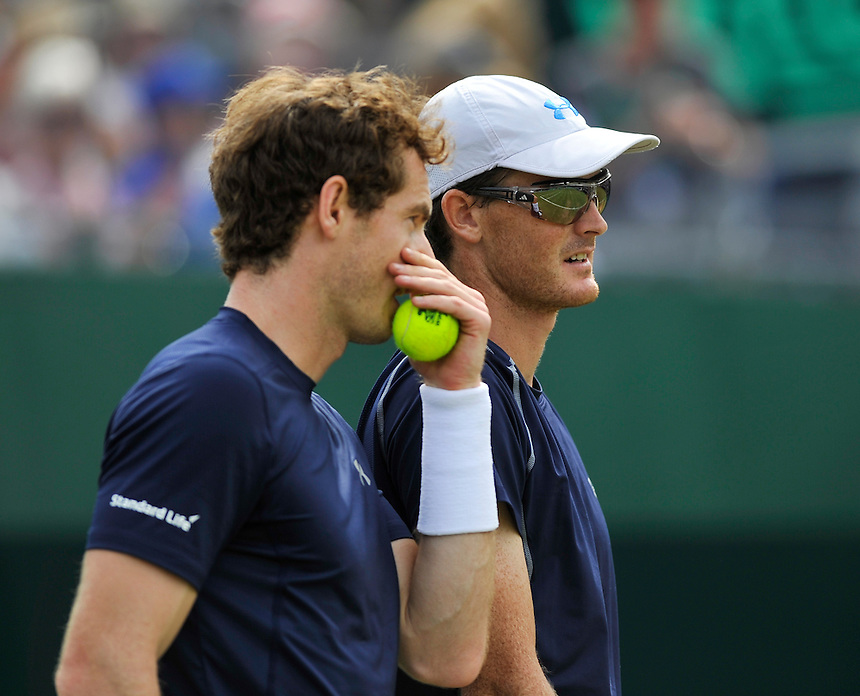 Andy Murray (with partner Jamie Murray) celebrates in the 3rd set against Jo-Wilfried Tsonga and Nicolas Mahut in their doubles match today - J Murray (GB) / A Murray (GB)def N Mahut (FRA) / J W Tsonga (FRA) 4-6, 6-3, 7-6, 6-1<br /> <br /> <br /> Photographer Ashley Western/CameraSport<br /> <br /> International Tennis - 2015 Davis Cup by BNP Paribas - World Group Quarterfinals - Great Britain v France - Day 2 - Saturday 18th July 2015 - Queens Club - London<br /> <br /> &copy; CameraSport - 43 Linden Ave. Countesthorpe. Leicester. England. LE8 5PG - Tel: +44 (0) 116 277 4147 - admin@camerasport.com - www.camerasport.com.