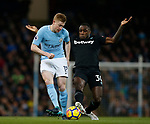 Kevin De Bruyne of Manchester City tackled by Michail Antonio of West Ham United during the premier league match at the Etihad Stadium, Manchester. Picture date 3rd December 2017. Picture credit should read: Andrew Yates/Sportimage