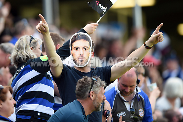 A Bath Rugby supporter in the crowd celebrates a try wearing a Matt Banahan mask. Aviva Premiership match, between Bath Rugby and London Irish on May 5, 2018 at the Recreation Ground in Bath, England. Photo by: Patrick Khachfe / Onside Images