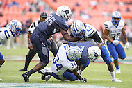 Washington, DC - September 16, 2016: Howard Bison running back Anthony Philyaw (7) gets tackled by several Hampton Pirates defenders during game between Hampton and Howard at  RFK Stadium in Washington, DC. September 16, 2016.  (Photo by Elliott Brown/Media Images International)
