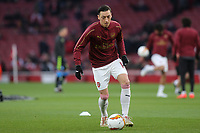 Mesut Ozil of Arsenal warms up ahead of kick-off during Arsenal vs Napoli, UEFA Europa League Football at the Emirates Stadium on 11th April 2019
