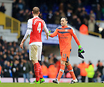 Arsenal's Per Mertesacker shakes hands with David Ospina at the final whistle<br /> <br /> - English Premier League - Tottenham Hotspur vs Arsenal  - White Hart Lane - London - England - 5th March 2016 - Pic David Klein/Sportimage
