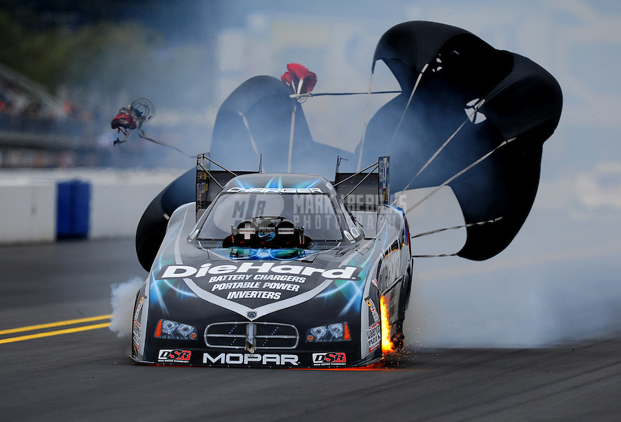 Sept. 17, 2011; Concord, NC, USA: NHRA funny car driver Matt Hagan blows an engine during qualifying for the O'Reilly Auto Parts Nationals at zMax Dragway. Mandatory Credit: Mark J. Rebilas-US PRESSWIRE