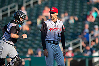 Arkansas Travelers manager Mitch Canham (12) walks back to the dugout during a Texas League game between the Northwest Arkansas Naturals and the Arkansas Travelers on May 30, 2019 at Arvest Ballpark in Springdale, Arkansas. (Jason Ivester/Four Seam Images)
