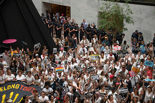 """United States Capitol Police stand in the background as the """"Women's March in Civil Disobedience to End Family Detention"""" is conducted in the atrium of the Hart Senate Office Building in Washington, DC on Thursday, June 28, 2018.  <br /> Credit: Ron Sachs / CNP<br /> (RESTRICTION: NO New York or New Jersey Newspapers or newspapers within a 75 mile radius of New York City)"""