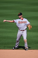 Salt River Rafters shortstop Jack Reinheimer (7) throws to first during an Arizona Fall League game against the Surprise Saguaros on October 20, 2015 at Salt River Fields at Talking Stick in Scottsdale, Arizona.  Surprise defeated Salt River 3-1.  (Mike Janes/Four Seam Images)