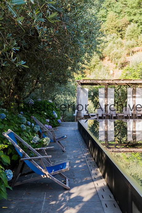 The raised mirror pool with a pergola to the rear is a stunning feature of the secluded garden.