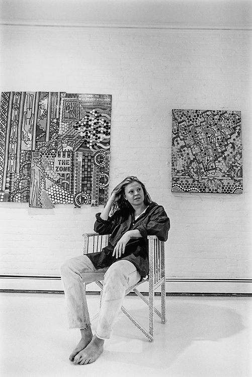 Tatiana Kaupp in her studio with two paintings and a chair painted by David Tull, one of the other artists exhibiting his work in the show beginning, on May 5, 1994. (Photo by Maureen Keating/CQ Roll Call via Getty Images)