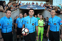 Cary, North Carolina  - Saturday August 05, 2017: Match officials Aaron Gallagher, Benjamin Wooten, Elvis Osmanovic, and John Krill prior to a regular season National Women's Soccer League (NWSL) match between the North Carolina Courage and the Seattle Reign FC at Sahlen's Stadium at WakeMed Soccer Park. The Courage won the game 1-0.