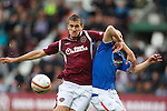 Kenny Miller hauled back in the box by Hearts defender Ismael Bouzid but no penalty awarded