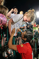 Marta (10) of the Western New York Flash signs autographs for fans after the game. The Western New York Flash defeated the magicJack 3-0 in Women's Professional Soccer (WPS) at Sahlen's Stadium in Rochester, NY May 22, 2011.3