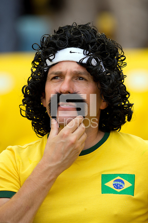 A Brazil fan with an excellent moustache