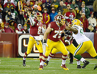 Washington Redskins quarterback Kirk Cousins (8) throws a pass in second quarter action against the Green Bay Packers at FedEx Field in Landover, Maryland on Sunday, November 20, 2016. Redskins offensive guard Brandon Scherff (75) provides the blocking. <br /> Credit: Ron Sachs / CNP /MediaPunch