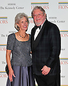 United States Secretary of Health and Human Services (HHS) Kathleen Sebelius arrives with her husband, Gary, for the formal Artist's Dinner at the United States Department of State in Washington, D.C. on Saturday, December 4, 2010..Credit: Ron Sachs / CNP.