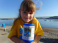 Pictured: Elly Neville fundraising <br /> Re: Seven-year-old Elly Neville who was born despite doctors saying her parents would not be able to have any more children, has raised over &pound;150,000 for the cancer ward that treated her father.<br /> Her parents Lyn and Ann had been told they were unlikely to have more children after he underwent a bone marrow transplant in 2005. <br /> Mr Neville subsequently spent a lot of time on the Ward 10 cancer facility at Withybush Hospital in Haverfordwest, Pembrokeshire.<br /> But four years later they were stunned when his painter and decorator wife Ann fell pregnant again.