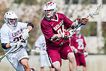 Los Angeles, CA 02/17/14 - Curtis Mackenzie (Santa Clara #24) and Michael Hanover (LMU #25) in action during the Santa Clara University - Loyola Marymount University MCLA's Men's lacrosse game at Loyola Marymount University.  Santa Clara defeated LMU 11-10 in overtime.