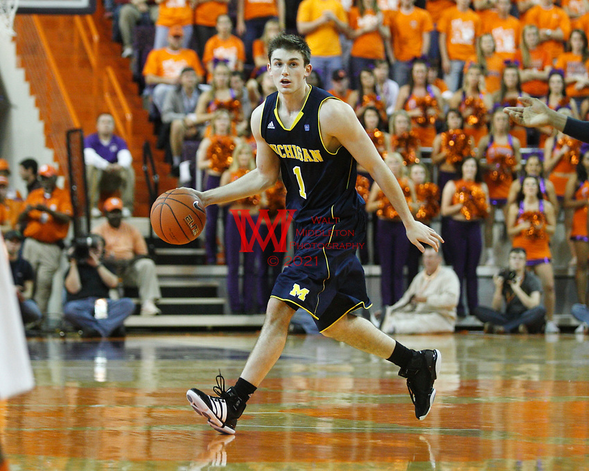 Nov 30, 2010; Clemson, SC, USA; Michigan Wolverines guard Stu Douglas (1) dribbles the ball at half court in the game against the Clemson Tigers at Littlejohn Coliseum. Mandatory Credit: Daniel Shirey/WM Photo -US PRESSWIRE