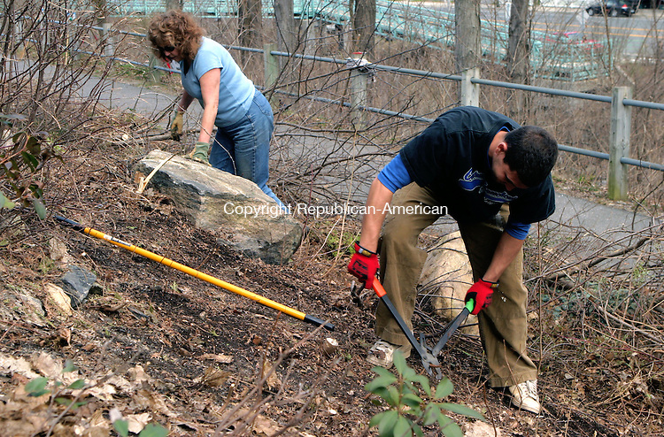 WINSTED, CT-08 APRIL 2009-041809JS24--Eddie Townsend and his mother Donna Townsend were among more that 50 volunteers to help clear brush andpick up litter along the Prospect Walk Way and the Mad River in downtown Winsted on Saturday. The project was organized by the Friends of Main Street. <br /> Jim Shannon Republican-American