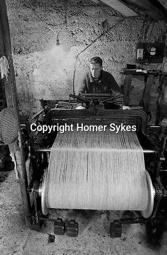 Cottage Industry, Shetland Islands, man on his loom producing cloth for local clothier and for export. 1970s Scotland...