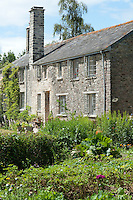 The Devon longhouse is flanked on one side by a walled kitchen garden where Carina grows fruit, herbs and vegetables
