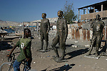 February 16, 2004. Gonaives, Haiti. The People for the Liberation of Haiti in Gonaives march for freedom. Rebels hold this northern city of Gonaives after Anti-Aristide  forces drove away the police and mayor. Rebels removed the statues that adorned the city square in Gonaive. The statues are of Haitian founders and Army leaders against the war of Independence against France.