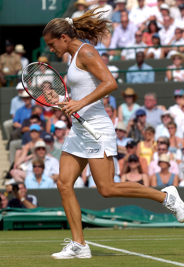 Photo: Richard Lane..Wimbledon Championships. 04/07/2006. .Amelie Mauresmo of France celebrates victory in her Quarter Final match.