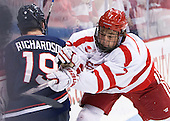 Evan Richardson (UConn - 19), Charlie McAvoy (BU - 7) - The Boston University Terriers defeated the visiting University of Connecticut Huskies 4-2 (EN) on Saturday, October 24, 2015, at Agganis Arena in Boston, Massachusetts.