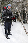 Hiker on Mount Tecumseh during the winter months. Located in the White Mountains, New Hampshire USA