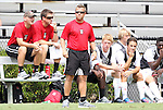 02 September 2012: NC State head coach Kelly Findley (standing) with assistants David Costa and Steven Cox. The North Carolina State University Wolfpack defeated the Santa Clara University Broncos 2-1 at Koskinen Stadium in Durham, North Carolina in a 2012 NCAA Division I Men's Soccer game.