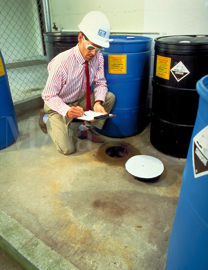 Man doing toxic inventory. Safety, environment, chemicals. man, men, occupations, hard hats, pollution.