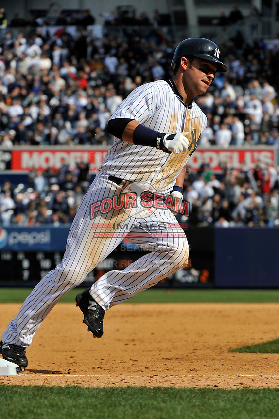 Apr 03, 2011; Bronx, NY, USA; New York Yankees outfielder Nick Swisher (33) during game against the Detroit Tigers at Yankee Stadium. Tigers defeated the Yankees 10-7. Mandatory Credit: Tomasso De Rosa
