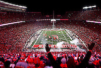 Fans cheer as the Ohio State Buckeyes run on to the field before the college football game between the Ohio State Buckeyes and the Illinois Fighting Illini at Ohio Stadium in Columbus, Saturday night, November 1, 2014. (The Columbus Dispatch / Eamon Queeney)