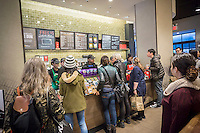 Busy Starbucks during the Starbucks Cheer promotional event in New York on Tuesday, December 27, 2016. For 10 days, excluding Christmas, Starbucks is giving away a tall espresso drink of your choice between the hours 1 and 2PM at a rotating choice of 100 stores around the country. (© Richard B. Levine)