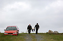 Presiding Officer Hugh O'Donnell and Garda Officer P.J. McHugh carry the ballot box off the island of Innishfree, County Donegal, Thursday, April 22, 2014 in the Irish Republic. The local home of Phil Currid was turned into a temporary Polling Station where Islanders Phil and Hans Schleweck formley of Stuttgart, Germany, cast their vote on the Donegal Island of Innishfree. The rest of Ireland will cast their votes tomorrow Friday May 23rd. A total of 2,131 people are registered to vote on 12 islands. In Donegal, where there are five islands, 753 people are entitled to vote. Photo/Paul McErlane