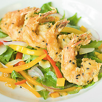 Sesame Crusted Shrimp on a Bed of Lettuce, Red Peppers, Yellow Peppers, Onions, and Tomatoes
