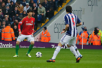 Saturday, 9 March 2013<br /> <br /> Pictured: Ki Sung-Yueng of Swansea City defends the ball<br /> <br /> Re: Barclays Premier League West Bromich Albion v Swansea City FC  at the Hawthorns, Birmingham, West Midlands